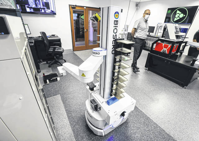 Imad Mansour, director of customer success at Biosero, demonstrates their mobile robot at Biosero headquarters on May 4, 2021, in San Diego, CA. Biosero makes a software platform called Green Button Go that manages workflow.