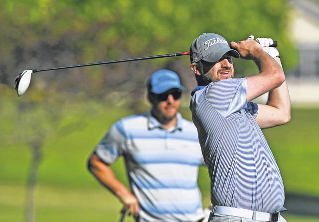 Jason Sarno watches his tee shot on the second hole Thursday during the the Lima City Men's Golf Championship at Springbrook Golf Club.