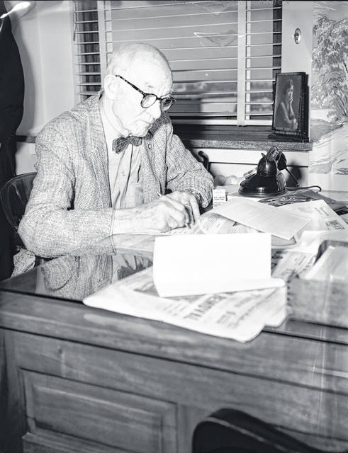 Fred Cook signs papers in 1962 to donate Cook Tower, 121-123 W. High St., to the city of Lima. The deal over the tallest building in Lima ended up falling through by the end of the year.