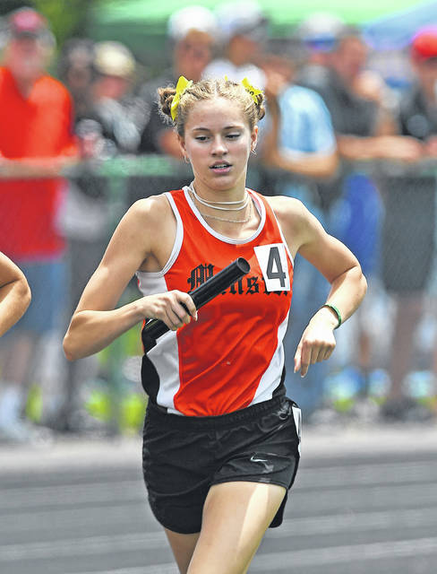 Minster's Ella Boate runs in the girls 3,200 relay during Friday's Division III State Track and Field Championships at Westervillle North High School.