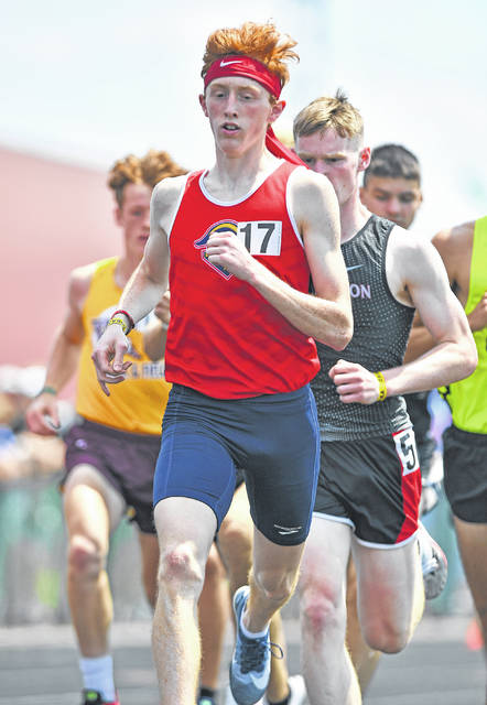 Perry's Brady Yingst competes in the boys 1,600 meter run during Saturday's Division III State Track and Field Championships at Westervillle North High School.
