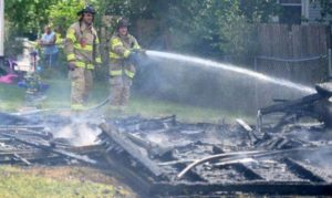 Two-car garage destroyed in Lima fire