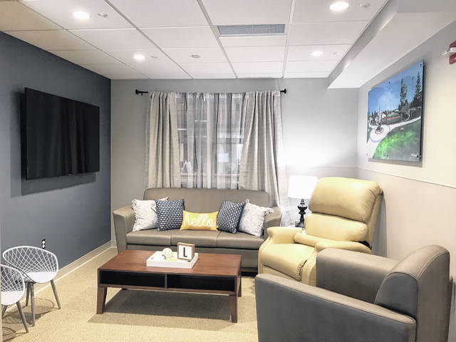 A living area designed to mimic a studio apartment helps patients regain basic skills, like sitting on the couch or unloading laundry.