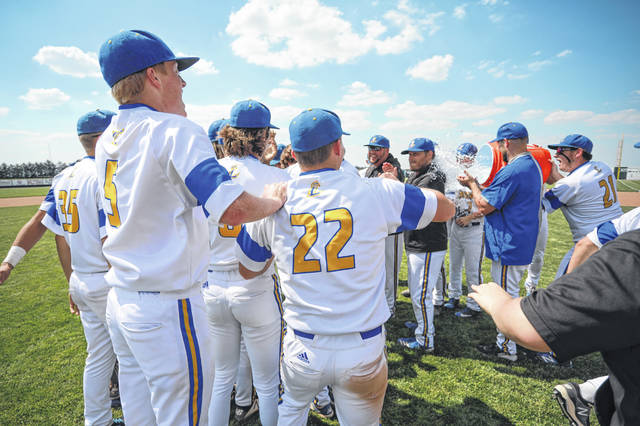 Lincolnview's Isaiah Peterson (21) douses head coach Eric Fishpaw as players and coaches celebrate defeating Leipsic in Saturday's Division IV regional final at Patrick Henry.
