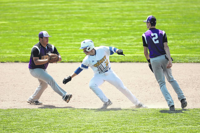 Lincolnview's Creed Jesse gets caught between against Leipsic's Adrian Carillo, left, and Mason Brandt during Saturday's Division IV regional final at Patrick Henry. See more baseball photos at LimaScores.com.