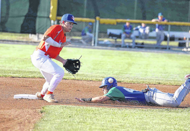Grand Lake's Marcus Ernst slides safely into the base as the Lima Locos' Garrett Howe waits on the throw during Wednesday night's game at Simmons Field. See more Locos photos at LimaScores.com.
