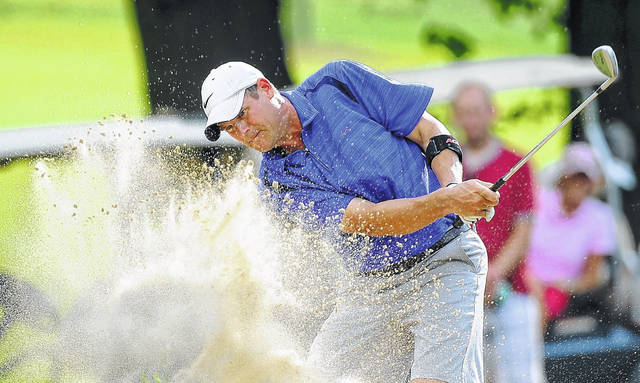 Two-time Lima City Men's Golf Championship champion Brian Kuhlman plays a shot from a bunker on the 14th hole at the Shawnee Country Club during his first of his championships in 2016 in this file photo.