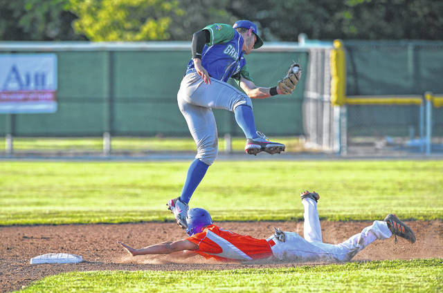 Trevor Austin of the Lima Locos slides under the tag attempt of Grand Lake's Ian Yunker during Friday night's game at Simmons Field.