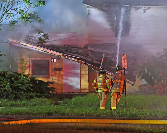 Lima firefighters battle a fire at an abandoned home at 402 N. Pine St. early Friday morning.
