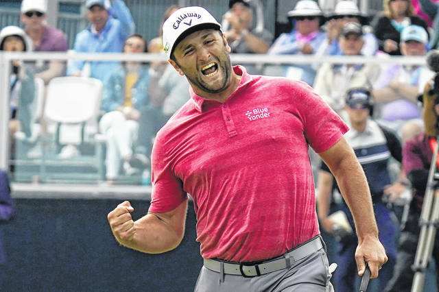 Jon Rahm reacts to making his birdie putt on the 18th green during the final round of the U.S. Open Golf Championship on Sunday at Torrey Pines Golf Course in San Diego.