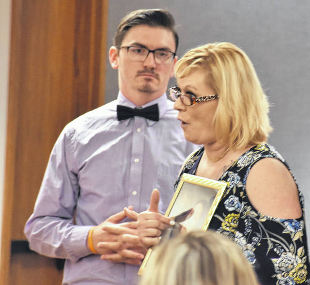 Heather Zeller, whose 18-year-old daughter Chance Edwards was struck and killed while walking along Dixie Highway last summer, held her daughter's photo as she addressed the court Thursday during a sentencing hearing for Bradley Pepple.