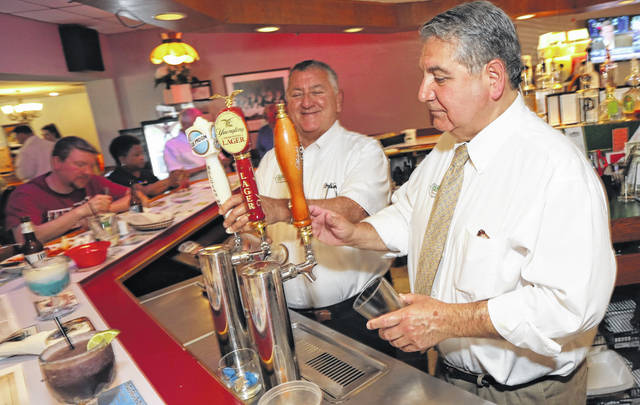 John Venturella, left, and brother Tony serve up a couple of beers to customers Thursday at the Casa Lu Al. The restaurant has been in their family for 61 years and will close Saturday night as the brothers retire.