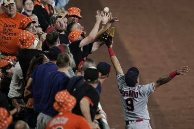 Cleveland's Eddie Rosario (9) is unable to prevent a ball hit by the Orioles' Ryan Mountcastle from reaching the stands during Friday night's game in Baltimore. (AP photo)