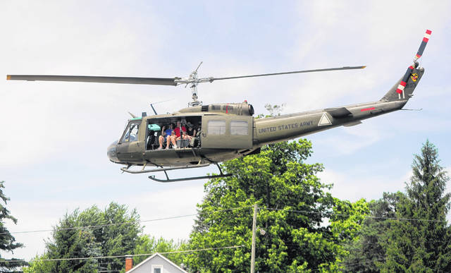 American Huey 369 gives rides during a Pork Rind Heritage Festival in Harrod in June of 2018.