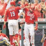 Brewers bullpen keeps Reds in check