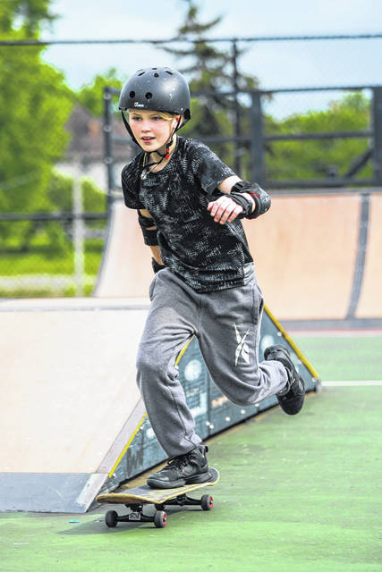 Joshua Layne skates around an obstacle at the Wapakoneta Skatepark. Admission to the outdoor skatepark is free, and wheels permitted include skateboards, rollerblades, scooters and BMXs.