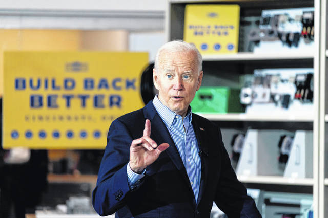 President Joe Biden speaks Wednesday while meeting with an instructor and an apprentice in a classroom at the IBEW / NECA Electrical Training Center in Cincinnati.