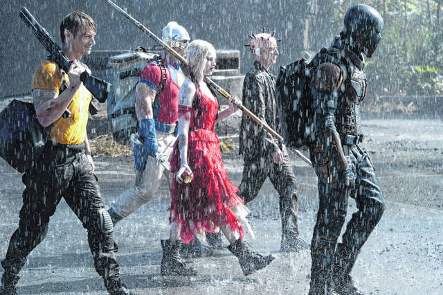"""This image provided by Warner Bros. Pictures shows Joel Kinnaman, from left, John Cena, Margot Robbie, Peter Capaldi and Idris Elba in a scene from """"The Suicide Squad."""""""