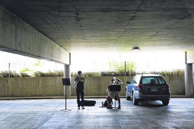 Northwestern music graduate students Timothy Maines and Alec Rich practice in a parking garage on June 22 near the Northwestern Bienen School of Music in Evanston, Illinois. Since the start of the pandemic, music students have been using the garages as practice spaces.