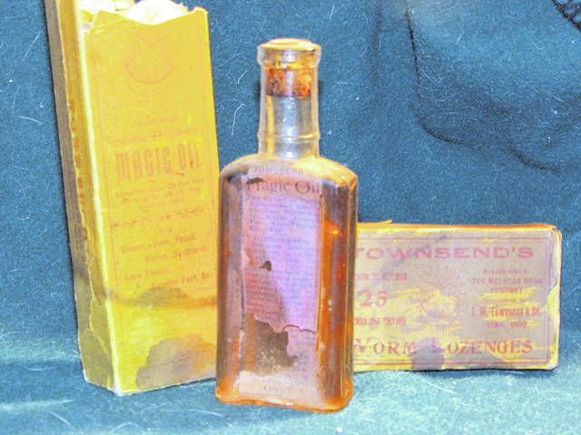 """A display at the Allen County Museum shows Charles M. Townsend's """"Worm Lozenges,"""" right, and his """"Magic Oil"""" container and bottle."""