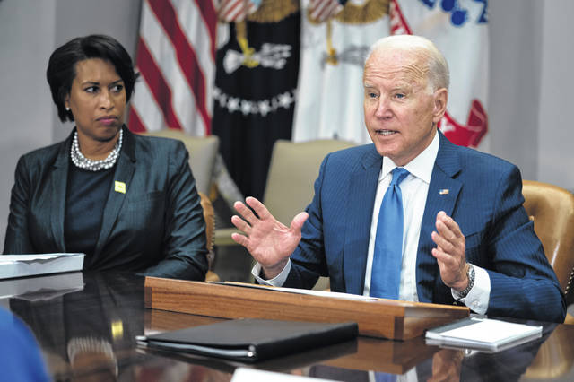 Washington Mayor Muriel Bowser listens as President Joe Biden speaks during a meeting on reducing gun violence, in the Roosevelt Room of the White House, Monday