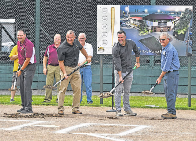 From Left:  Joe Recker, Karl Lammers, Jeff Krouse, and Roger Hanneman dig the first shovels of dirt during the ground breaking ceremony for a $2 million update to St. Michael's Holy Name Ballpark in Kalida on Monday.