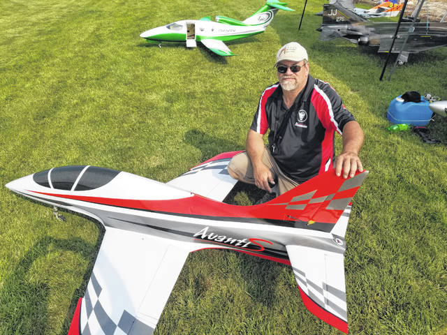 Gary Williams, of Lima, shows off his Avanti jet and the Epic model he also owns behind him.