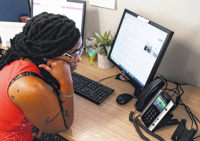 """Courtney Spann listens to callers at the Regional Housing Crisis Hotline in Chesapeake, Virginia on Tuesday, June 29, 2021. """"I know where they're coming from,"""" she said of her clients. """"I'm just trying my best to get them assistance."""""""