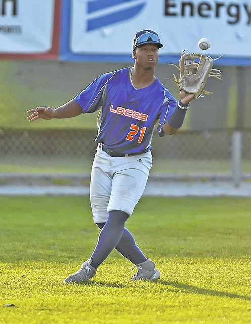The Lima Locos' T.J. Reeves fields a flyball during Saturday night's Game 3 of the Great Lakes Summer Collegiate League championship series against the Hamilton Joes at Simmons Field.