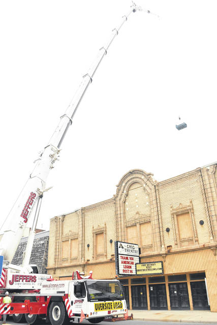 Roofing materials were hoisted to the roof of Lima's historic Ohio Theatre on Friday in anticipation of the replacement of three levels of roofing on the structure. Crews from Cotterman and Co. of Minster will begin work on Monday.