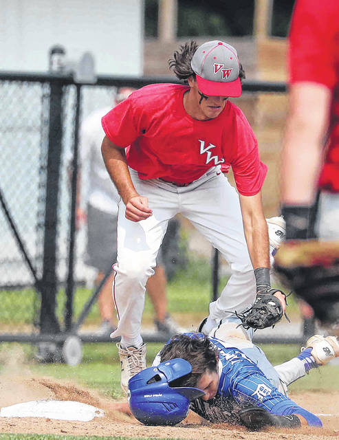 Van Wert's Aidan Pratt tries to get the tag on Defiance's David Jiminez as Jimenez slides safe into third base during action on Ed Sandy field at Elida Schools at the state ACME semi-final Monday.