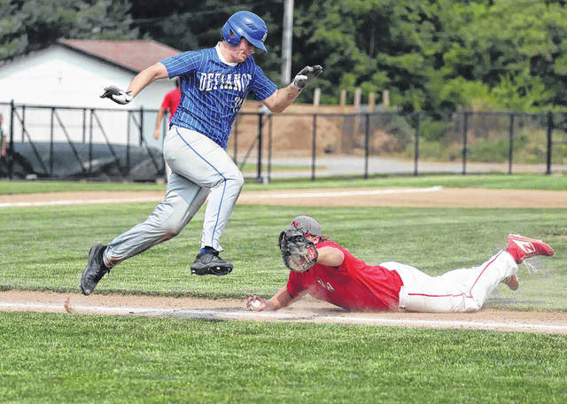 Definace's Mark Butler tries to avoid the tag of Van Wer's Turner Witten after Butler layed down a bunt during action on Ed Sandy field at Elida Schools at the state ACME semi-final Monday. More photos are available at limaohio.com