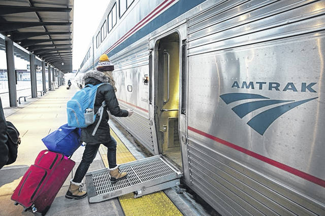 Passengers board an Amtrak train in Minnesota. Amtrak's new train fleet will operate on the Northeast Corridor and state-supported routes, including the Keystone Service and the Pennsylvanian.
