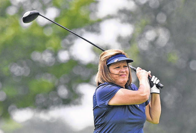 Connie Mauch watches her tee shot during Saturday's Lima Area Women's semifinals at the Hidden Creek Golf Club.
