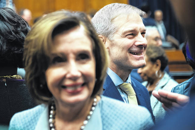 UNITED STATES - FEBRUARY 27: Rep. Jim Jordan, R-Ohio, and Speaker of the House Nancy Pelosi, D-Calif., attend an event to dedicate the Oversight and Reform Committee hearing room to the late Chairman Elijah Cummings, D-Md., in Rayburn Building on Thursday, February 27, 2020. (Photo By Tom Williams/CQ Roll Call via AP Images)