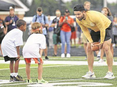Cleveland Browns quarterback Baker Mayfield talks with participants Wednesday during the Baker Mayfield ProCamp in Gates Mills.