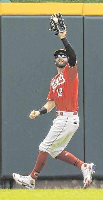 The Reds' Tyler Naquin makes a catch during Wednesday's game against the New York Mets in Cincinnati.