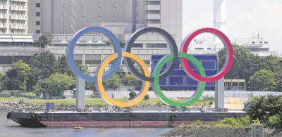The Olympic rings float on a barge in Tokyo.
