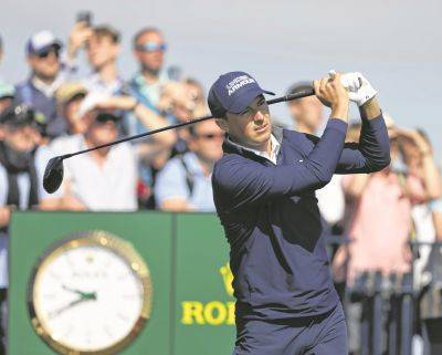 Jordan Spieth watches his tee shot at the second hole during Thursday's first round of the British Open at Royal St George's in Sandwich, England.