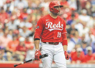 The Reds' Joey Votto reacts to striking out during Wednesday's game against the New York Mets in Cincinnati.
