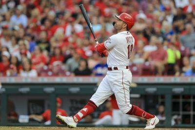 The Reds' Joey Votto watches his solo home run during the third inning of Tuesday night's game against the New York Mets in Cincinnati. (AP photo)
