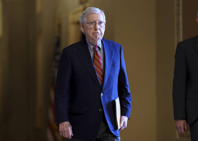 """Senate Minority Leader Mitch McConnell, R-Ky., walks to the chamber as the Senate works to advance the $1 trillion bipartisan infrastructure bill Monday in Washington. He described the bill Monday as a """"good and important jumping off point"""" for a robust, bipartisan amendment process. He also warned Democrats against setting """"any artificial timetable."""""""