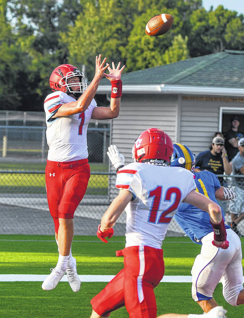 Lima Central Catholic's Carson Parker makes a touchdown reception during Saturday night's game at Stadium Park in Delphos.