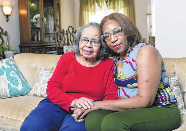 Jacqueline Winsett, left, of North Point Breeze, poses July 20 for a portrait at her home with her daughter Jacqueline Winsett Ruple in Pittsburgh. Winsett's husband, Joseph, has suffered from Alzheimer's disease and she and her daughter have taken care of him.