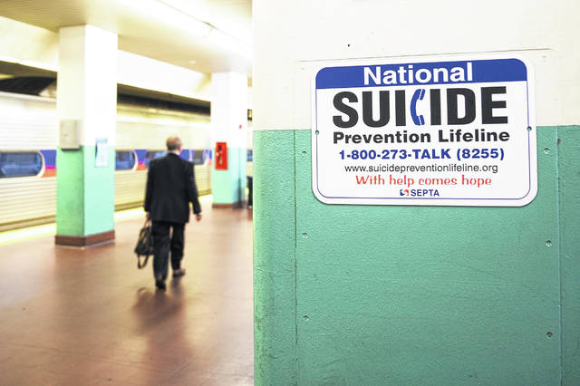 A sign for suicide prevention is displayed on the train platform at Suburban Station in Center City Philadelphia on October 31, 2019.