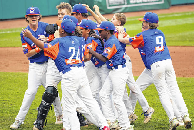 Taylor, Mich. players celebrate their win over Hamilton, Ohio, in the Little League World Series Championship baseball game in South Williamsport, Pa. on Sunday.