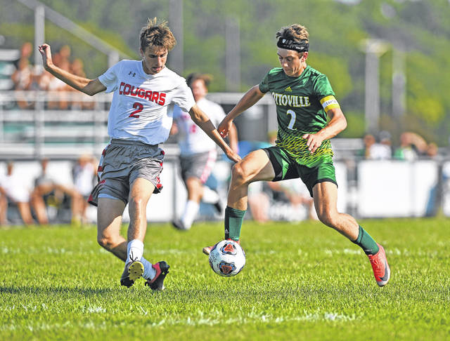 Ottoville's Will Miller, right, competes for the ball against Van Wert's Sam Moonshower during Tuesday's match at Ottoville. See more match photos on 6B.