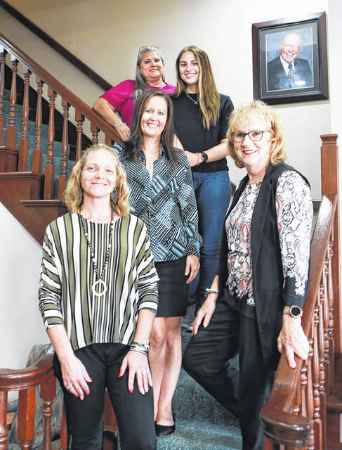 Pamela Daley-Jennings of First Lima Title Agency has never seen a booming house market like the one currently. She is shown with her staff, from left: Michelle Brooks, Staci Freeman, Lauren Jennings and Barbara Figgins.