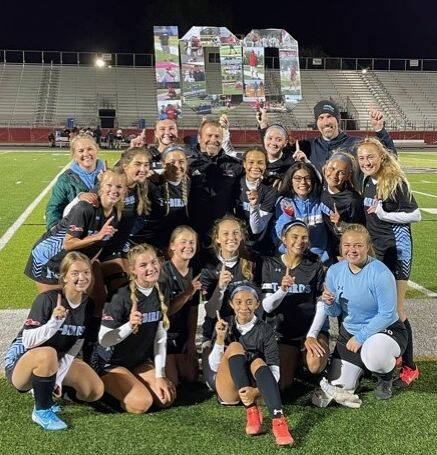 Lima Central Catholic girls soccer coach Mike Santiguida is joined by players and others after earning his 100th career victory with a 2-0 win Thursday night against Spencerville. Photo provided
