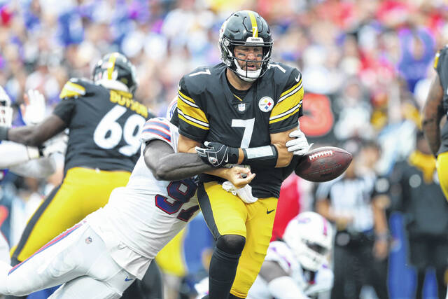 Buffalo Bills defensive end Mario Addison (97) strips the ball from Pittsburgh Steelers quarterback Ben Roethlisberger (7) during the first half of an NFL football game in Orchard Park, N.Y., Sunday. The Bills recovered the ball.